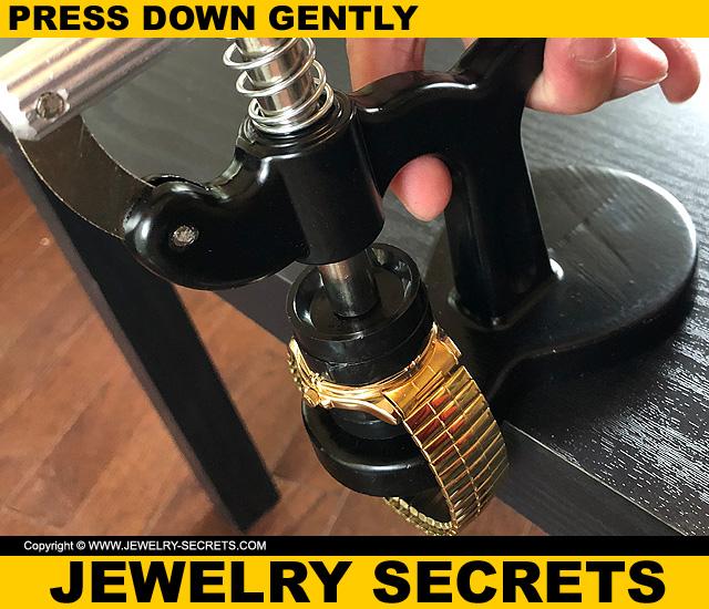 Press Down Handle On Watch Press Until Back Snaps Onto Wrist Watch